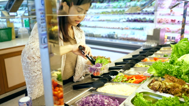 young woman selecting fresh salad - vegan stock videos and b-roll footage