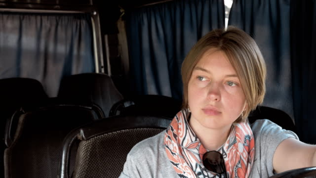 Young woman setas in the bus video