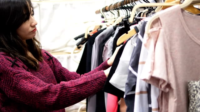 young woman shopping in retail store - preppy fashion stock videos and b-roll footage