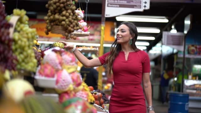 Young woman shopping on the local market Visiting Fruit Market only young women stock videos & royalty-free footage