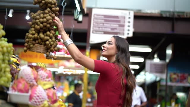 young woman shopping on the local market - south america travel stock videos and b-roll footage