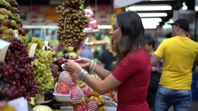 Young woman shopping on the local market video