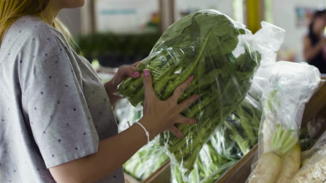 Young Woman Shopping Vegetable In Fresh Market video