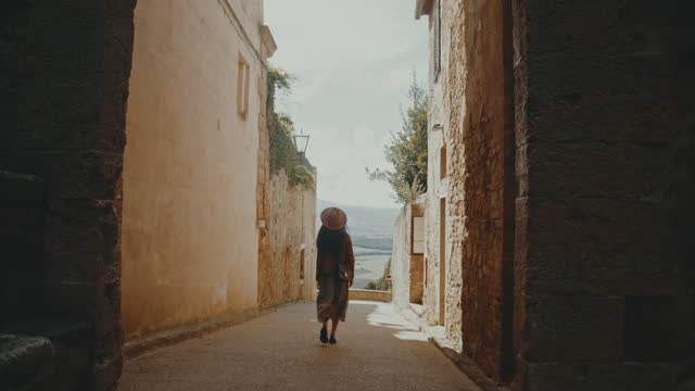 SLO MO Young woman sightseeing the town Pienza