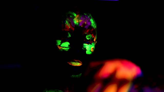 young woman silhouette with fluorescent imprint on face video