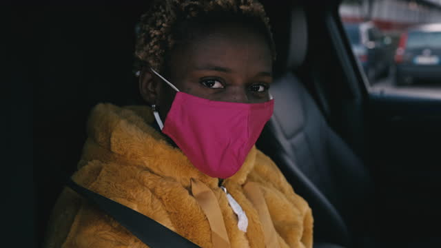 Young woman sitting in the car video