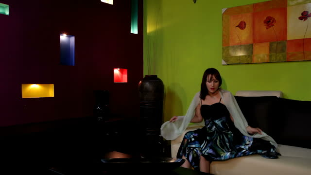 Young woman sitting in the modern livingroom video