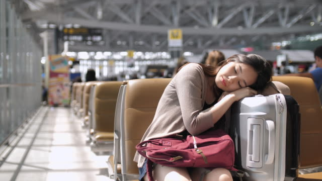 Young woman Sleep At The Airport waiting for her flight video