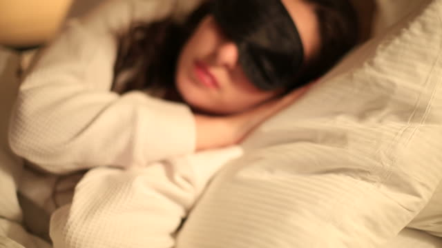 Young Woman Sleeping in Bed video