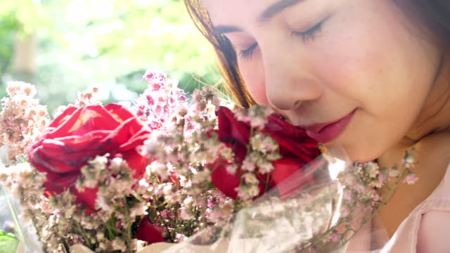 Young woman Smell flower bouquet woman,flower bunch stock videos & royalty-free footage