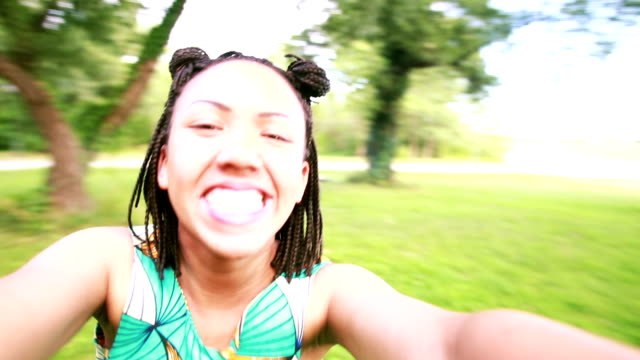 Young woman smiling and taking a selfie video
