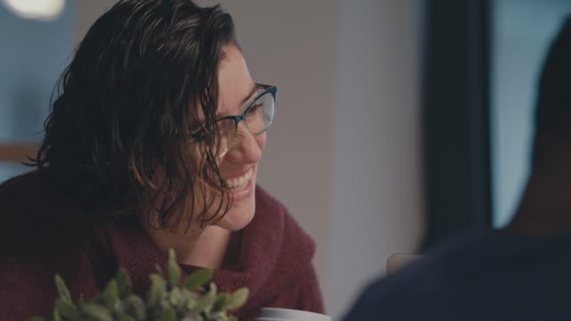 Young woman smiling during a business meeting with her colleagues Selec