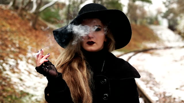 Young woman smoking a cigarette video
