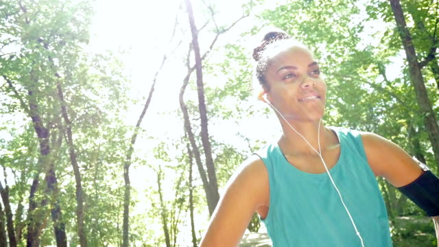 Young woman stretching before off road running in park video