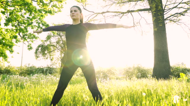 Young woman stretching in nature. video