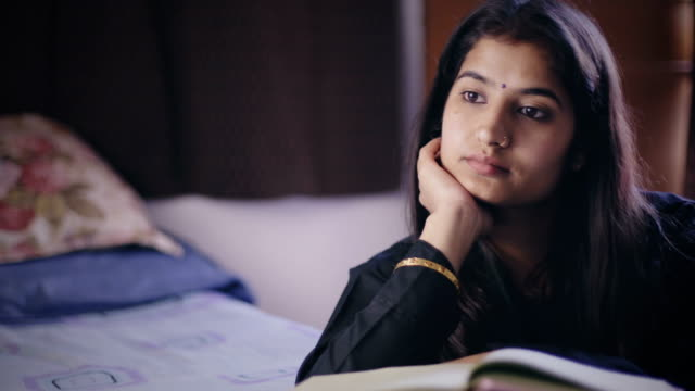 Young woman studying and thinking. video