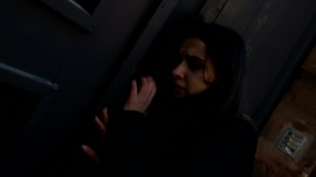 vídeos de stock e filmes b-roll de young woman suffering from panic attack, knocking on closed door, addiction - door knock