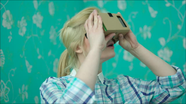 Young Woman Surprised with Virtual Reality video