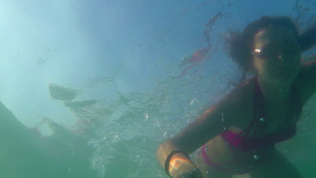 Young woman swimming underwater video