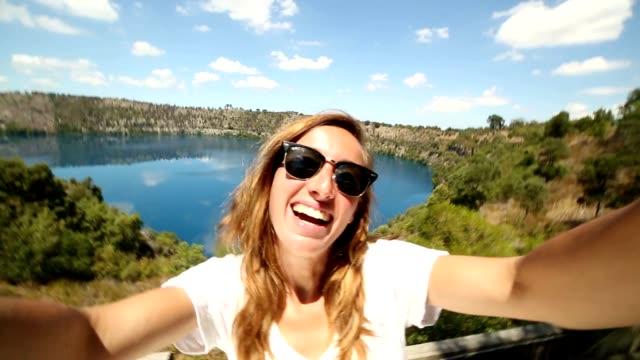 Young woman takes selfie portrait at Blue lake, South Australia video