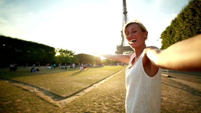 Young woman talking a selfie at the Eiffel tower video