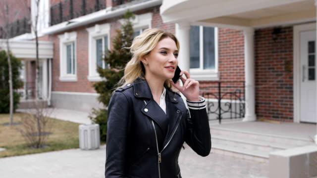 Young woman talking on mobile phone video