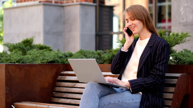 Young Woman Talking on Phone, Negotiating in Good Mood video