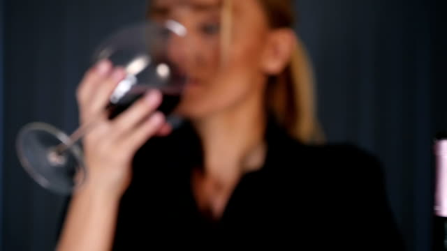 Young woman tasting red wine video