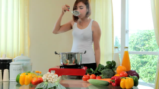 Young woman tasting soup video