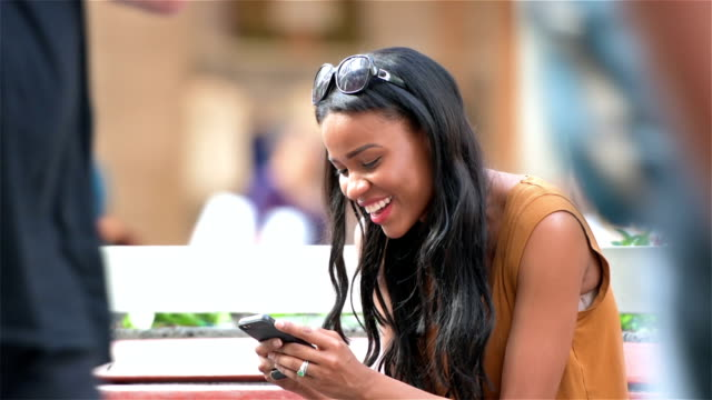 Young woman texting happily video