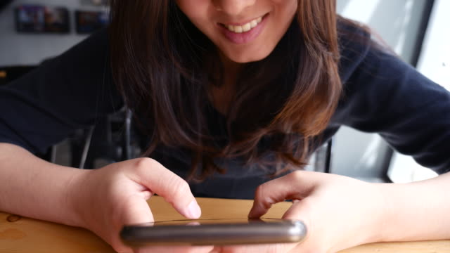 young woman texting on cell phone - bassino video stock e b–roll