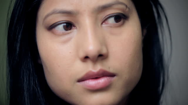 young woman thinking deeply. - distrarre lo sguardo video stock e b–roll