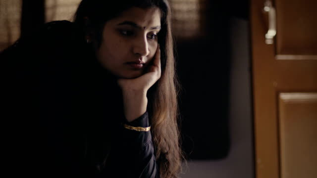 A young woman thinking. video