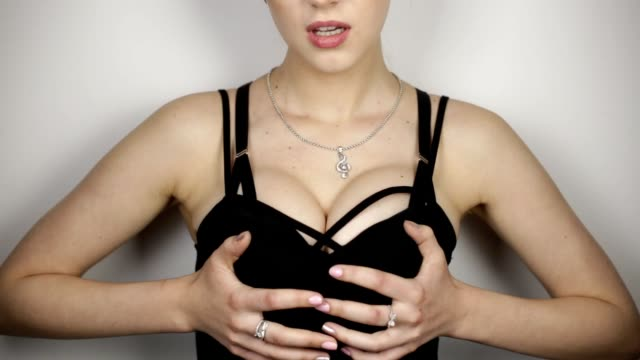 young woman touches breast. loop - decolleté video stock e b–roll
