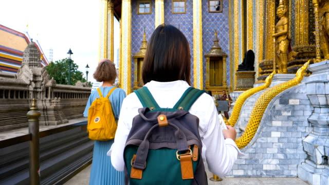 Young woman tourist traveling in Grand Palace at Bangkok Thailand
