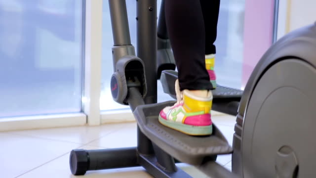 Young woman training in a gym closeup video