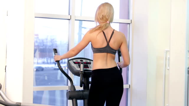 Young woman training in a gym video
