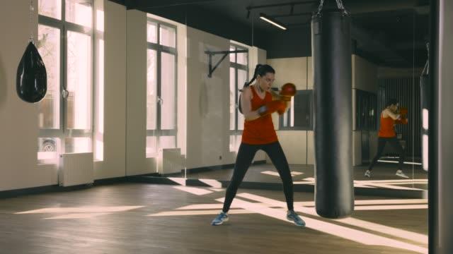 Young woman training punching bag video