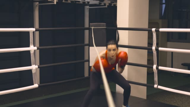 Young woman trains in Boxing ring video
