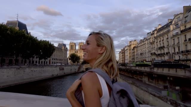 Young woman traveling in Paris walking near Notre Dame, Paris- France video
