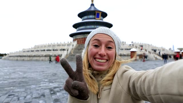 Young woman traveling takes selfie with Temple of Heaven,Beijing video