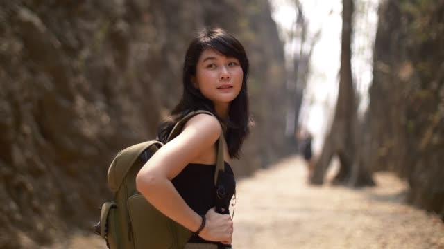 young woman travelling in rock mountain smilling enjoy weeken video