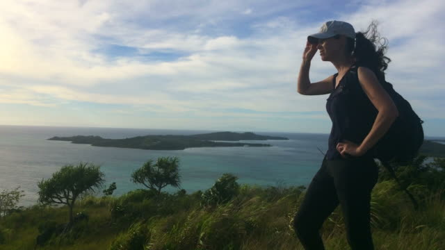 Young woman travels and hikes in tropical Island terrain video