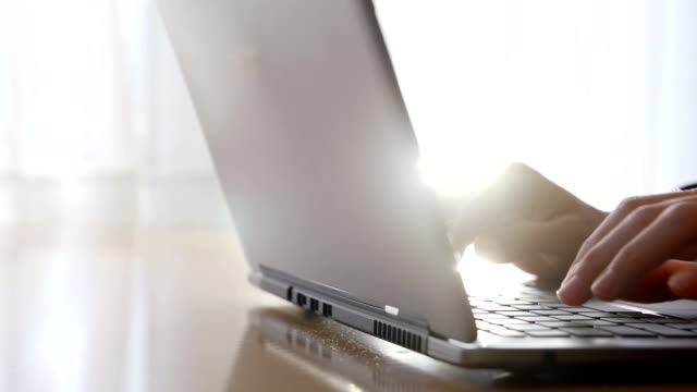 Young woman typing on laptop keyboard video