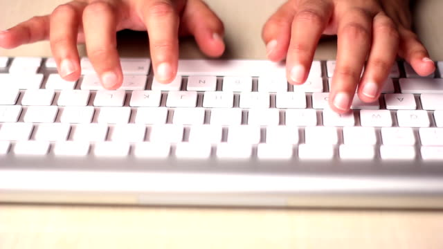 Young Woman typing on the keyboard video