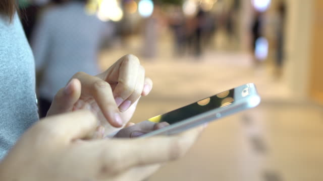 young woman typing smartphone video