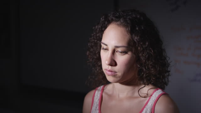 Young woman under stress Young adult female dealing with stress and looking depressed defibrillator stock videos & royalty-free footage