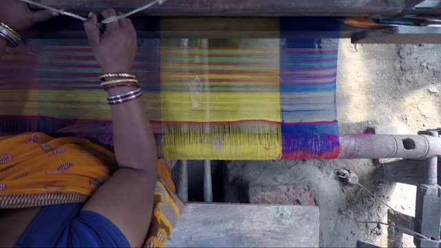 Young woman uses village loom. Top view, tracking shot. Bengal, India sari stock videos & royalty-free footage