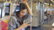 istock Young woman using a Smart phone on Subway 998613136