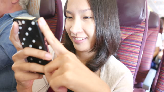 HD Young woman using cellphone video